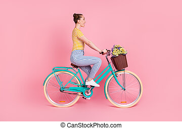 Full size profile photo of optimistic nice brunette ride bicycle wear t-shirt pants isolated on pink background