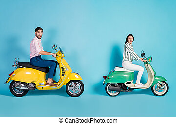 Full size profile side photo crazy shocked wife husband rider bikers drive motor bike impressed incredible street trip view wear formalwear pants trousers isolated blue color background