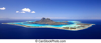 Full View of Bora Bora Lagoon, French Polynesia from above on a near cloudless day. Prime honeymoon destination