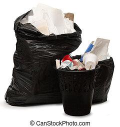 Full wastebasket and plastic bag - Full black wastebasket ...