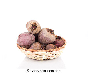 Full wicker basket with beetroot.