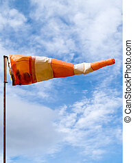 Full wind cone weather vane on windy day - Red and white...