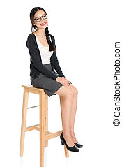 Fullbody young Asian female seated