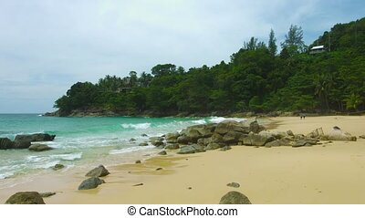 Beautiful little beach with golden sand and rocks. Thailand, Phuket