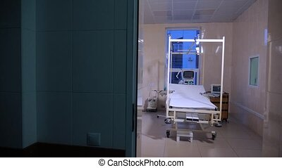 Fully-equipped hospital ward with empty bed. Burn clinic...