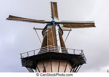 """A fully restored and operational windmill named """"De Koe' (the Cow) in the village of Ermelo in the province of Gelderland in the Netherland"""