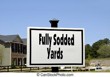 Fully Sodded Yards - Realty Sign advertising Fully Sodded...