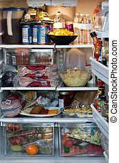 Fully Stocked Refrigerator - An open refrigerator door...