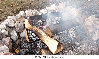 Fuming campfire