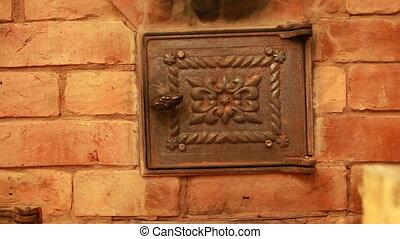 fuming stove cast iron firebox door close-up