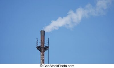 fuming tube against blue sky pipe industry smoke blue sky environmental pollution outdoors