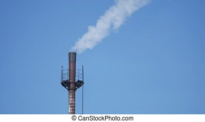 fuming tube against blue sky pipe industry smoke blue the sky environmental pollution outdoors