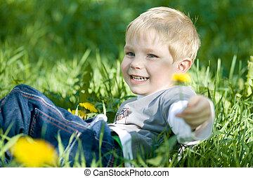 fummy summer - Happy kid lie on green grass