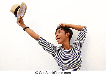 Fun african american girl cheering with arms raised