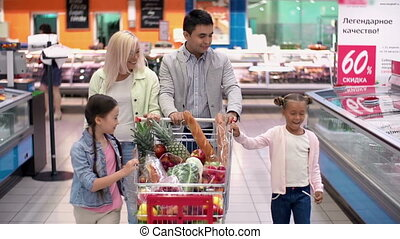 Fun and Profuse - Pull back of family in supermarket...