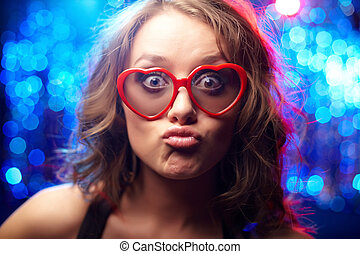 Fun at party - Funny girl wearing heart-shaped glasses at...
