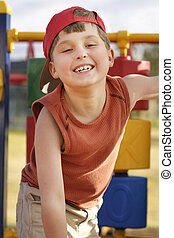 Fun at playground - Giggling child on playground equipment