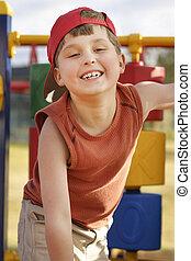 Fun at playground - Giggling child on playground equipment