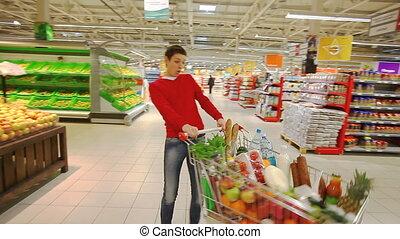 Fun at shopping mall - Cheerful young man having fun in...