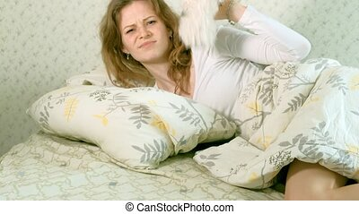 Fun awakening woman throwing a soft toy 4k