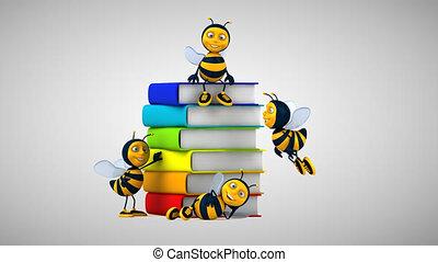 Fun bees next to books