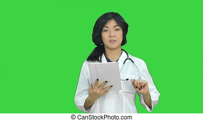 Fun cheerful asian girl dancing looking at camera on a Green Screen, Chroma Key