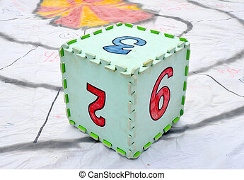 Fun colorful toy puzzle cube or dice in textured foam for kids to learn their numbers 2 , 3,9