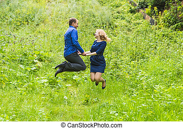 Fun couple in jump on the outdoor