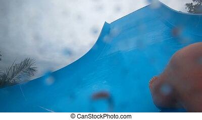 Fun down the water slide - First person view: Senior man...