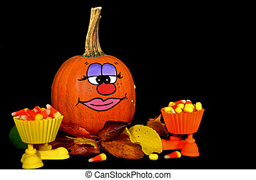 fun face on pumpkin with candy