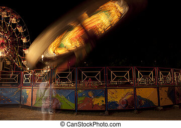Fun fair at night. Blurred lights.