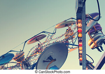 Fun Fair - Image of colorful light bulbs with fun ride in...