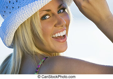 A beautiful young woman turning and laughing for the camera