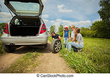 Fun friendly family is on a picnic. A car breakdown.