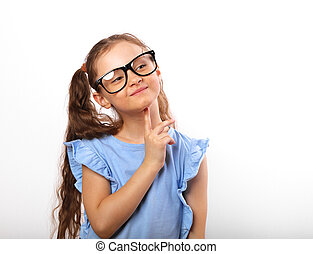 Fun grimacing happy girl in eye glasses thinking and looking up on white isolated background with empty copy spase