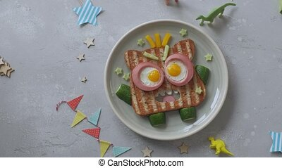 Fun Halloween monster sandwich with slice ham, eggs and ...
