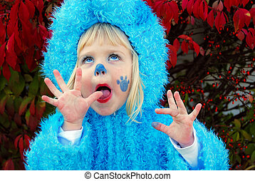 Fun In Fur - Little girl with a comical expression in...
