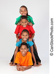 Fun kids form a totem pole