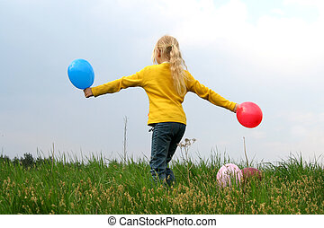Fun - Little girl dancing with balloons