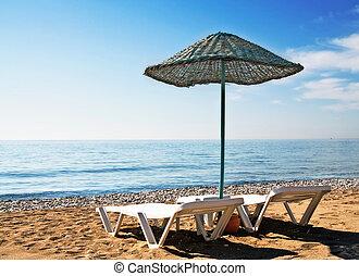 Fun parasol and beach in resort.