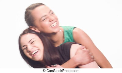 fun pastime of two girlfriends - two best friends hugging...