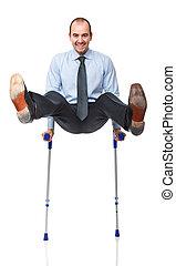 fun patient - young caucasian man with crutch has fun...