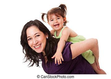 Fun piggyback ride - Happy laughing toddler girl playing...