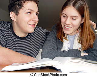 Fun reading - 2 teenagers reading a book