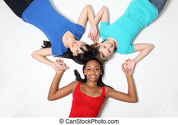 Fun star shape by three teenage girl friends