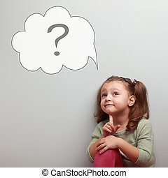 Fun thinking kid looking up on idea cloud bubble with question sign inside on empty copy space blue background