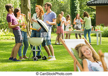 Fun with barbecue - Two young couples having fun with...