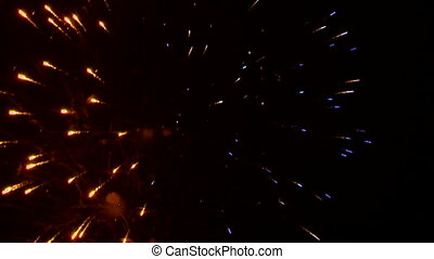 Very beautiful and colorful fireworks in the night sky.