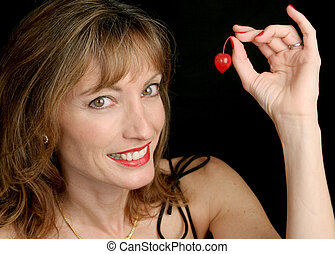 Fun With Fruit - A beautiful, sexy woman, smiling and ...