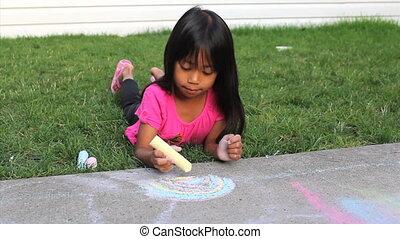 Fun With Sidewalk Chalk - A cute little Asian girl enjoys...